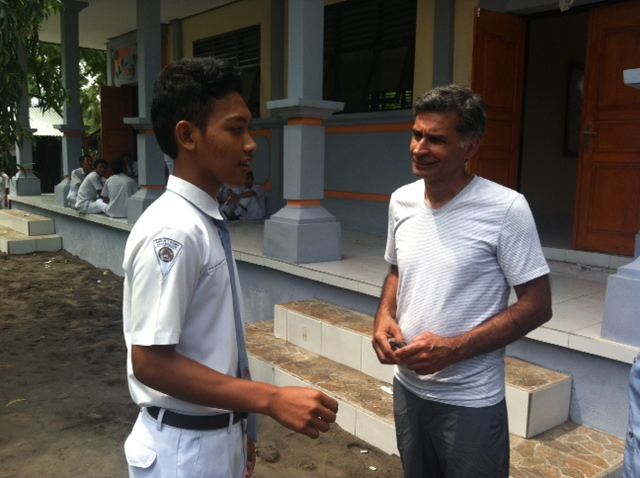 Discussing School with Western Visitor